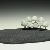 huddle. porcelain, flocking, brazing rod. 8 in. x 8 in. x 4 in. 2011.