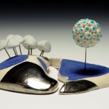 adhere. porcelain, luster, flocking, brazing rod, glaze, silicone adhesive. 6 in. x 8 in. 6 in. 2011