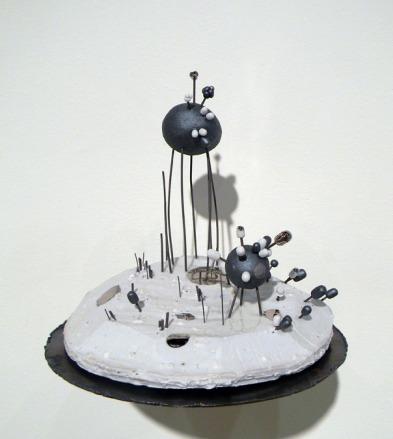 asphalt's parakeet. porcelain, black clay, nichrome wire, glaze, luster, steel. 2013