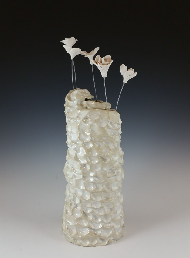 10,690 Wild Flowers, Vase 1, Stoneware, glaze, porcelain, nichrome wire. 2017. All flowers were made during discussions centered on Reproductive Justice in OR and culminated in a discussion workshop in collaboration with local organizations Forward Together, Momentum Alliance and Western States Center. Flowers are sold for $1 each and all funds raised go to the Network for Reproductive Options, an abortion fund for Oregon and Idaho. 2017