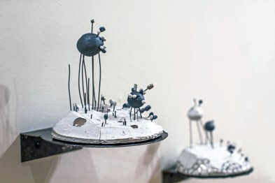 mountain series. porcelain, black clay, nichrome wire, glaze, silver luster, hand made steel shelves. 2015. Image by Jim Benedict.