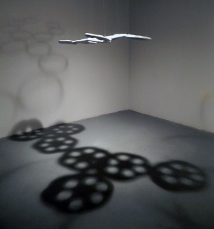 suggestion of place. ceramic, monofilament, wood, glaze, light. 4 ft. x 4 ft. x 11 ft. area installed. 2013